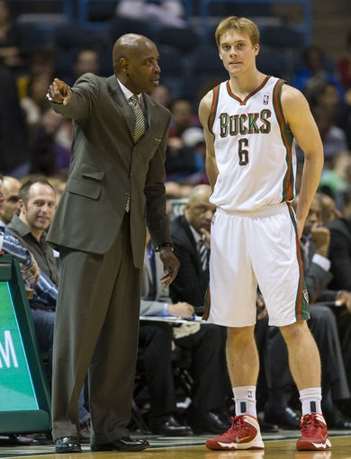 Nov 23, 2013; Milwaukee, WI, USA; Milwaukee Bucks head coach Larry Drew talks with guard Nate Wolters (6) during the fourth quarter against the Charlotte Bobcats at BMO Harris Bradley Center. Mandatory Credit: Jeff Hanisch-USA TODAY Sports