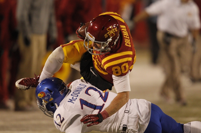 Nov 23, 2013; Ames, IA, USA; Iowa State Cyclones receiver Justin Coleman (80) dives over Kansas Jayhawks defender Dexter McDonald (12) in the third quarter at Jack Trice Stadium. Mandatory Credit: Bruce Thorson-USA TODAY Sports