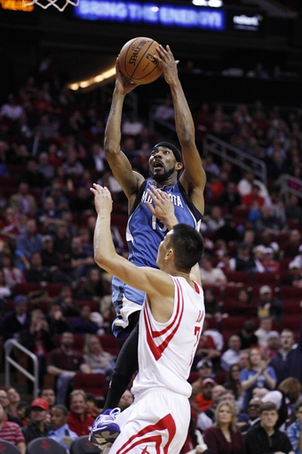 Nov 23, 2013; Houston, TX, USA; Minnesota Timberwolves small forward Corey Brewer (13) shoots over Houston Rockets point guard Jeremy Lin (7) during the third quarter at Toyota Center. Mandatory Credit: Andrew Richardson-USA TODAY Sports