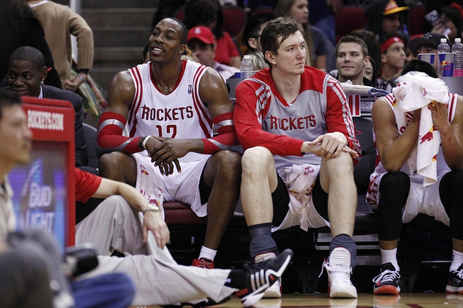 Nov 23, 2013; Houston, TX, USA; Houston Rockets power forward Dwight Howard (12) and center Omer Asik (3) on the bench during the fourth quarter against the Minnesota Timberwolves at Toyota Center. Mandatory Credit: Andrew Richardson-USA TODAY Sports