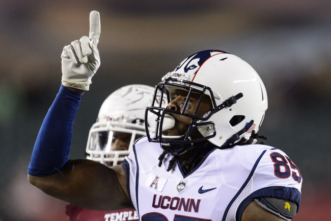 Nov 23, 2013; Philadelphia, PA, USA; Connecticut Huskies wide receiver Geremy Davis (85) celebrates making a first down during the third quarter against the Temple Owls at Lincoln Financial Field. UCONN defeated Temple 28-21. Mandatory Credit: Howard Smith-USA TODAY Sports