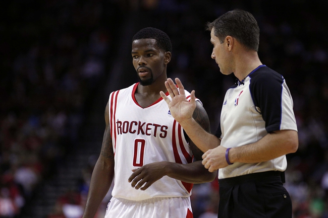 Nov 23, 2013; Houston, TX, USA; Houston Rockets point guard Aaron Brooks (0) speaks to an official during the third quarter against the Minnesota Timberwolves at Toyota Center. Mandatory Credit: Andrew Richardson-USA TODAY Sports
