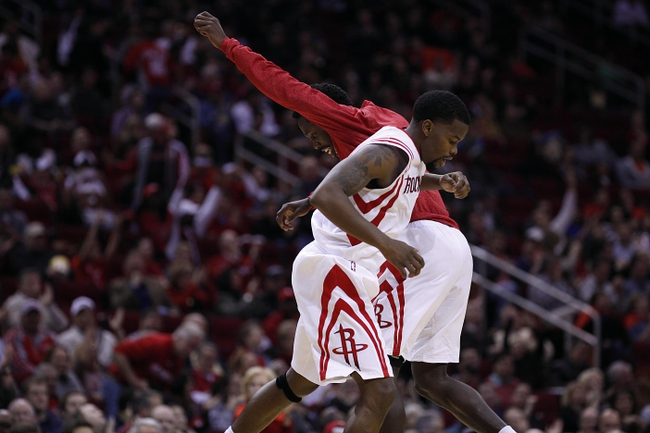 Nov 23, 2013; Houston, TX, USA; Houston Rockets point guard Aaron Brooks (0) and point guard Patrick Beverley (2) celebrate during the fourth quarter against the Minnesota Timberwolves at Toyota Center. Mandatory Credit: Andrew Richardson-USA TODAY Sports