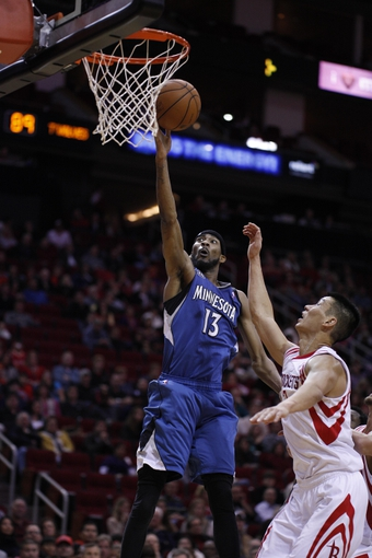 Nov 23, 2013; Houston, TX, USA; Minnesota Timberwolves small forward Corey Brewer (13) shoots the ball during the fourth quarter at Toyota Center. Mandatory Credit: Andrew Richardson-USA TODAY Sports
