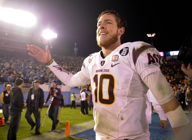 Nov 23, 2013; Pasadena, CA, USA; Arizona State Sun Devils quarterback Taylor Kelly (10) celebrates after beating the UCLA Bruins at Rose Bowl. Mandatory Credit: Robert Hanashiro-USA TODAY Sports