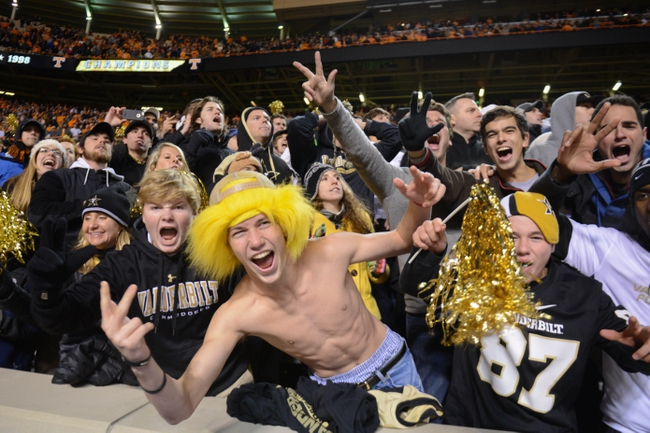Nov 23, 2013; Knoxville, TN, USA; Vanderbilt Commodores fans celebrate after winning the game against the Tennessee Volunteers at Neyland Stadium. Vanderbilt won 14 to 10. Mandatory Credit: Randy Sartin-USA TODAY Sports