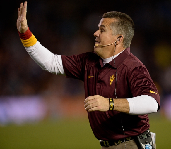 Nov 23, 2013; Pasadena, CA, USA; Arizona State Sun Devils head coach Todd Graham signals to his players during the second half against the UCLA Bruins at Rose Bowl. Mandatory Credit: Robert Hanashiro-USA TODAY Sports