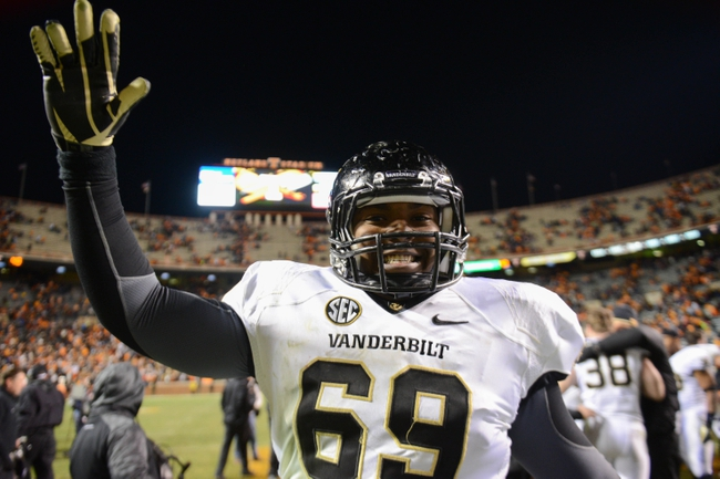 Nov 23, 2013; Knoxville, TN, USA; Vanderbilt Commodores defensive tackle Adam Butler (69) celebrates after the game against the Tennessee Volunteers at Neyland Stadium. Vanderbilt won 14 to 10. Mandatory Credit: Randy Sartin-USA TODAY Sports