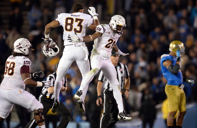 Nov 23, 2013; Pasadena, CA, USA; Arizona State Sun Devils wide receiver Alante Wright (83) and Arizona State Sun Devils wide receiver Jaelen Strong (21) celebrate as time runs out in the Sun Devils win over the UCLA Bruins at Rose Bowl. Mandatory Credit: Robert Hanashiro-USA TODAY Sports