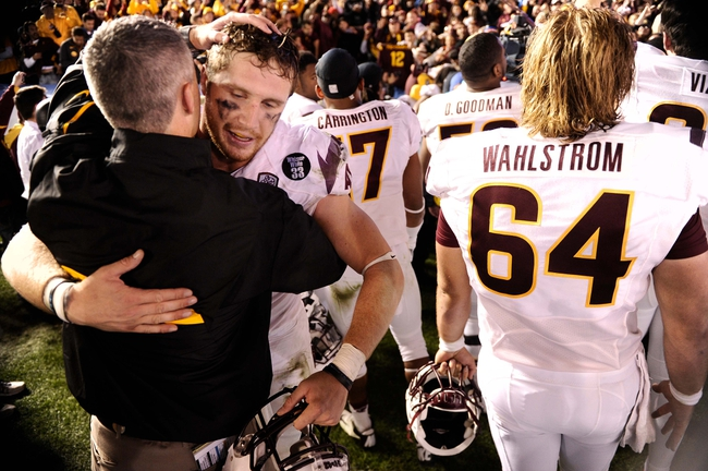 Nov 23, 2013; Pasadena, CA, USA; Arizona State Sun Devils tight end Chris Coyle (87) gets a hug after the Sun Devils win over over UCLA Bruins at Rose Bowl. Mandatory Credit: Robert Hanashiro-USA TODAY Sports