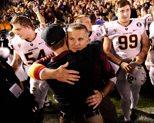 Nov 23, 2013; Pasadena, CA, USA; Arizona State Sun Devils head coach Todd Graham gets a hug after the Sun Devils beat the UCLA Bruins at Rose Bowl. Mandatory Credit: Robert Hanashiro-USA TODAY Sports