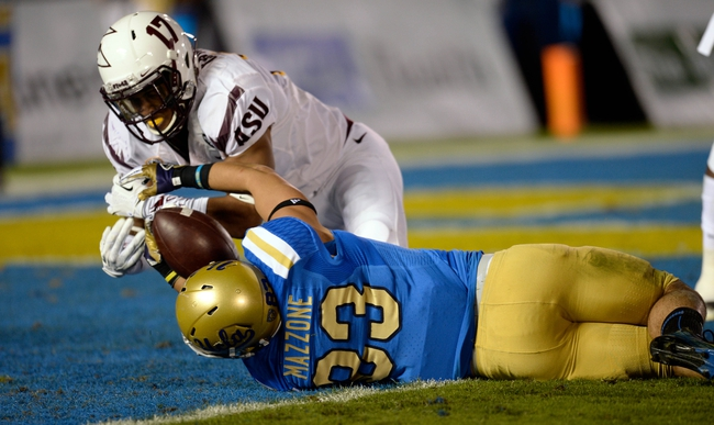 Nov 23, 2013; Pasadena, CA, USA; UCLA Bruins running back Steven Manfro (33) is stopped short of the goal line by Arizona State defensive back Lloyd Carrington (17) during second half action at Rose Bowl. Mandatory Credit: Robert Hanashiro-USA TODAY Sports