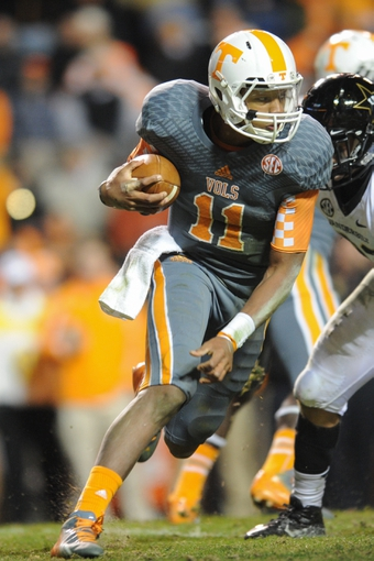 Nov 23, 2013; Knoxville, TN, USA; Tennessee Volunteers quarterback Joshua Dobbs (11) runs the ball against the Vanderbilt Commodores at Neyland Stadium. Vanderbilt won 14 to 10. Mandatory Credit: Randy Sartin-USA TODAY Sports