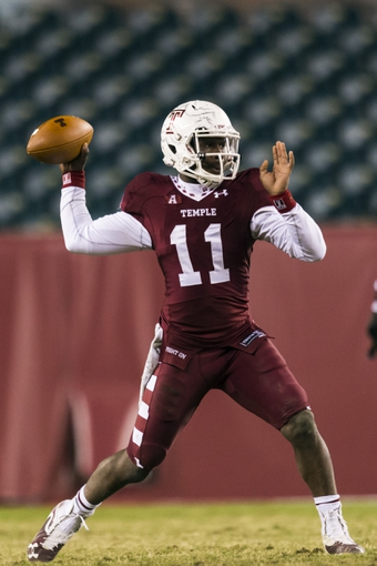 Nov 23, 2013; Philadelphia, PA, USA; Temple Owls quarterback P.J. Walker (11) passes the ball during the fourth quarter against the Connecticut Huskies at Lincoln Financial Field. UCONN defeated Temple 28-21. Mandatory Credit: Howard Smith-USA TODAY Sports
