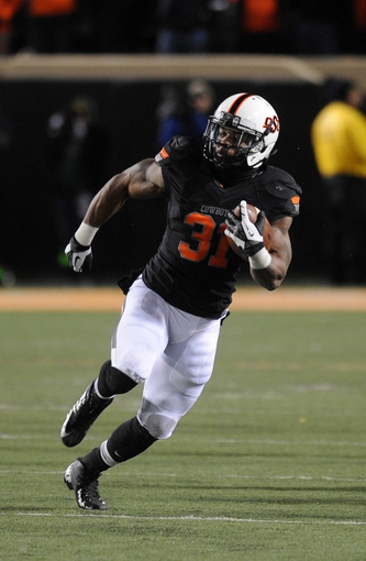 Nov 23, 2013; Stillwater, OK, USA;  Oklahoma State Cowboys running back Jeremy Smith (31) runs the ball against the Baylor Bears at Boone Pickens Stadium. Mandatory Credit: Mark D. Smith-USA TODAY Sports
