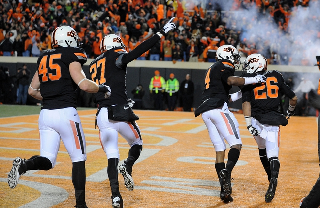 Nov 23, 2013; Stillwater, OK, USA; Multiple Oklahoma State Cowboys celebrate after Cowboys cornerback Tyler Patmon (26) ran a fumble recovery for a touchdown against the Baylor Bears at Boone Pickens Stadium. Mandatory Credit: Mark D. Smith-USA TODAY Sports