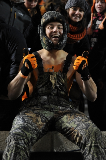 Nov 23, 2013; Stillwater, OK, USA;  Oklahoma State Cowboys fan Cooper Pollman celebrates his team's victory against the Baylor Bears at Boone Pickens Stadium. The Cowboys defeated the Bears 49-17. Mandatory Credit: Mark D. Smith-USA TODAY Sports