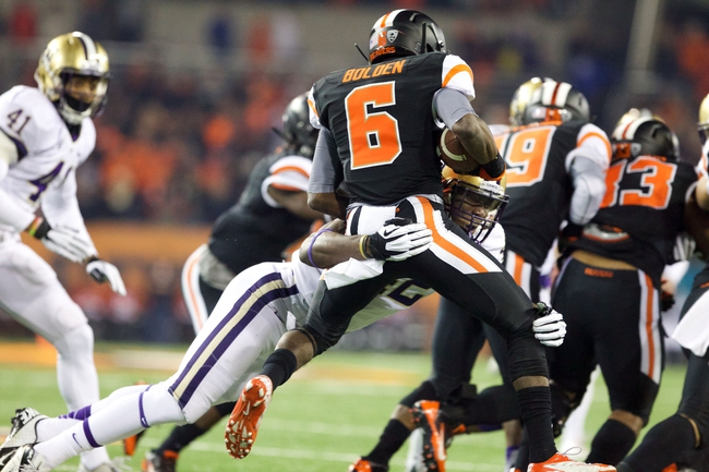 Nov 23, 2013; Corvallis, OR, USA; Washington Huskies linebacker Cory Littleton (42) tackles Oregon State Beavers wide receiver Victor Bolden (6) during a kickoff return in the first half at Reser Stadium. Mandatory Credit: Jaime Valdez-USA TODAY Sports