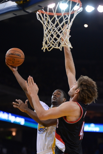 November 23, 2013; Oakland, CA, USA; Golden State Warriors small forward Harrison Barnes (40, left) shoots the ball against Portland Trail Blazers center Robin Lopez (42) during the fourth quarter at Oracle Arena. The Trail Blazers defeated the Warriors 113-101. Mandatory Credit: Kyle Terada-USA TODAY Sports