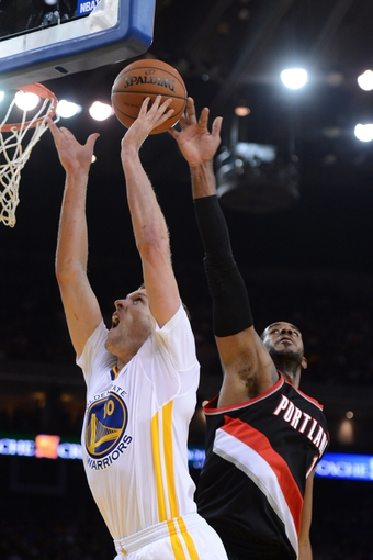 November 23, 2013; Oakland, CA, USA; Golden State Warriors power forward David Lee (10) shoots the ball against Portland Trail Blazers power forward LaMarcus Aldridge (12) during the fourth quarter at Oracle Arena. The Trail Blazers defeated the Warriors 113-101. Mandatory Credit: Kyle Terada-USA TODAY Sports