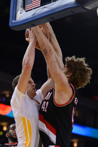 November 23, 2013; Oakland, CA, USA; Golden State Warriors power forward David Lee (10) shoots the ball against Portland Trail Blazers center Robin Lopez (42) during the fourth quarter at Oracle Arena. The Trail Blazers defeated the Warriors 113-101. Mandatory Credit: Kyle Terada-USA TODAY Sports
