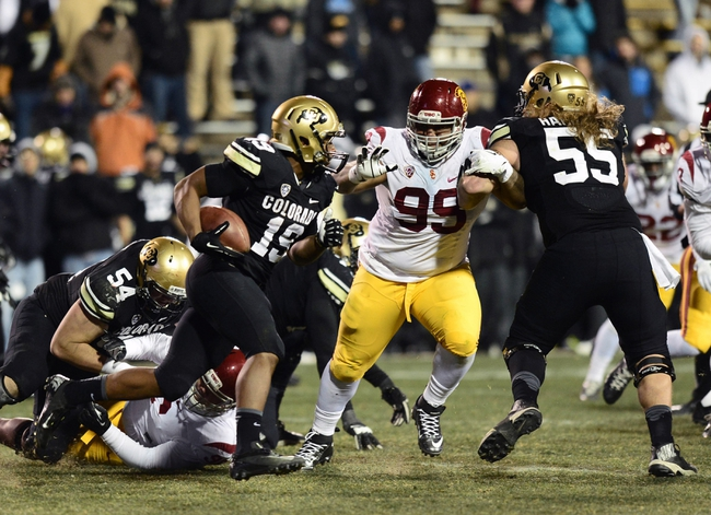 Nov 23, 2013; Boulder, CO, USA; Colorado Buffaloes running back Michael Adkins II (19) rushes as Southern California Trojans defensive tackle Antwaun Woods (99) chases behind the block of offensive linesman Gus Handler (55) in the fourth quarter at Folsom Field. The Trojans defeated the Buffaloes 47-29. Mandatory Credit: Ron Chenoy-USA TODAY Sports