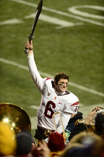 Nov 23, 2013; Boulder, CO, USA; Southern California Trojans quarterback Cody Kessler (6) reacts with fans following the win over the Colorado Buffaloes in the fourth quarter at Folsom Field. The Trojans defeated the Buffaloes 47-29. Mandatory Credit: Ron Chenoy-USA TODAY Sports