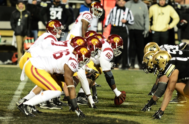 Nov 23, 2013; Boulder, CO, USA; Southern California Trojans quarterback Cody Kessler (6) lines up under center across from the Colorado Buffaloes in the fourth quarter at Folsom Field. The Trojans defeated the Buffaloes 47-29. Mandatory Credit: Ron Chenoy-USA TODAY Sports