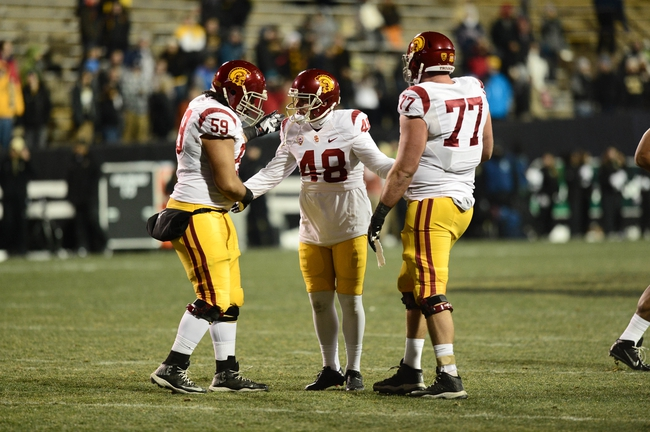 Nov 23, 2013; Boulder, CO, USA; Southern California Trojans kicker Andre Heidari (48) is congratulated for his thirty nine yard field goal by guard John Martinez (59) and offensive tackle Kevin Graf (77) in the fourth quarter against the Colorado Buffaloes at Folsom Field. The Trojans defeated the Buffaloes 47-29. Mandatory Credit: Ron Chenoy-USA TODAY Sports