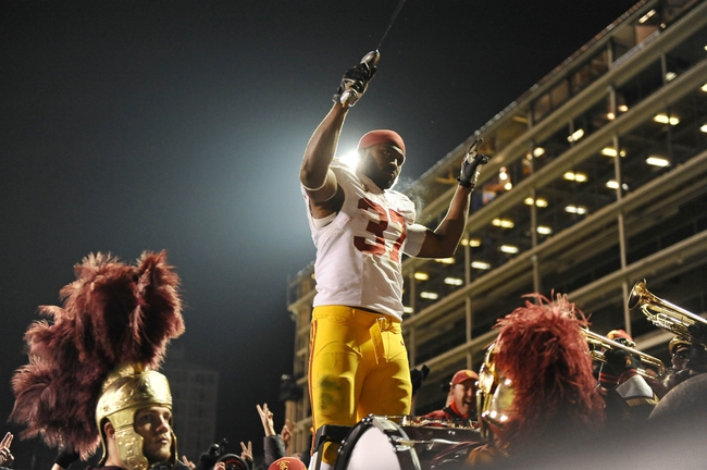 Nov 23, 2013; Boulder, CO, USA; Southern California Trojans running back Javorius Allen (37) reacts with fans following the win over the Colorado Buffaloes in the fourth quarter at Folsom Field. The Trojans defeated the Buffaloes 47-29. Mandatory Credit: Ron Chenoy-USA TODAY Sports
