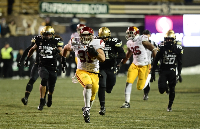 Nov 23, 2013; Boulder, CO, USA; Southern California Trojans fullback Soma Vainuku (31) rushes for a long touchdown in the fourth quarter against the Colorado Buffaloes at Folsom Field. The Trojans defeated the Buffaloes 47-29. Mandatory Credit: Ron Chenoy-USA TODAY Sports