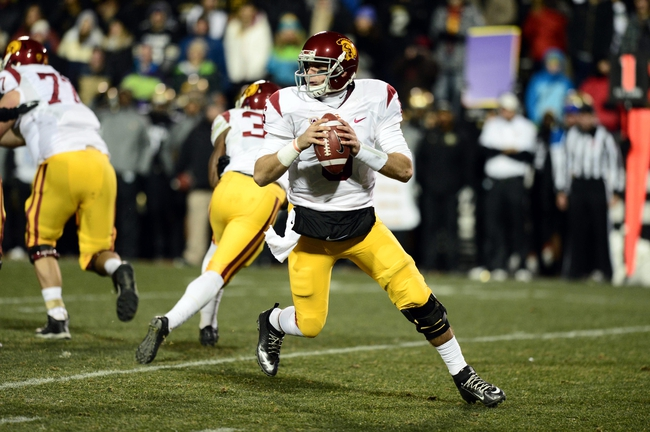 Nov 23, 2013; Boulder, CO, USA; Southern California Trojans quarterback Cody Kessler (6) drops back to pass in the second quarter against the Colorado Buffaloes at Folsom Field. The Trojans defeated the Buffaloes 47-29. Mandatory Credit: Ron Chenoy-USA TODAY Sports