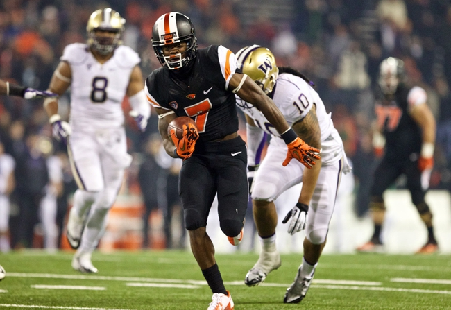 Nov 23, 2013; Corvallis, OR, USA; Oregon State Beavers wide receiver Brandin Cooks (7) scores a touchdown against the Washington Huskies in the second half at Reser Stadium. Mandatory Credit: Jaime Valdez-USA TODAY Sports