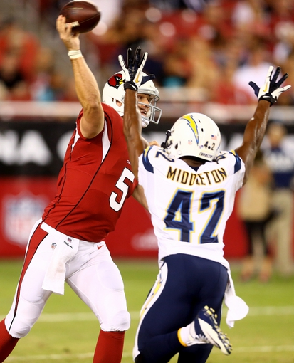 Aug. 24, 2013; Glendale, AZ, USA: Arizona Cardinals quarterback Drew Stanton (left) against the San Diego Chargers during a preseason game at University of Phoenix Stadium. Mandatory Credit: Mark J. Rebilas-USA TODAY Sports