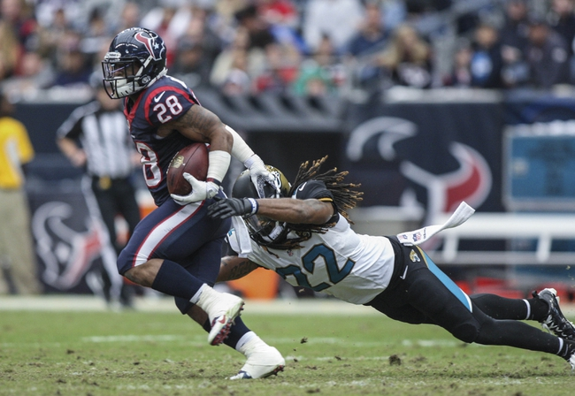 Nov 24, 2013; Houston, TX, USA; Houston Texans running back Dennis Johnson (28) runs with the ball during the second quarter as Jacksonville Jaguars defensive back Winston Guy (22) attempts to make a tackle at Reliant Stadium. Mandatory Credit: Troy Taormina-USA TODAY Sports