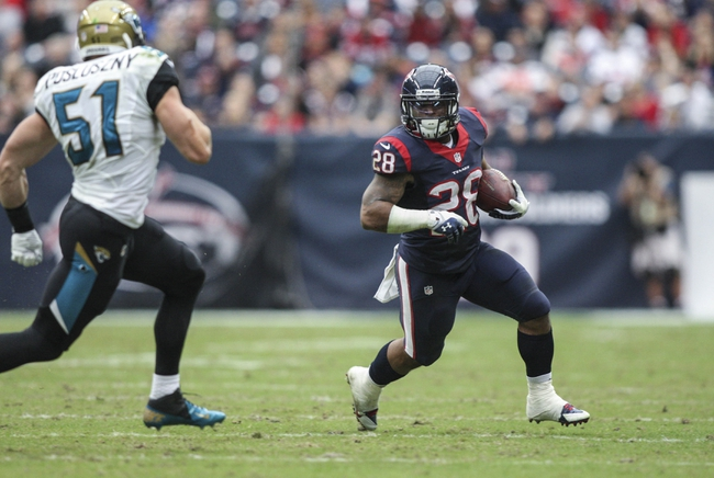 Nov 24, 2013; Houston, TX, USA; Houston Texans running back Dennis Johnson (28) makes a reception during the second quarter as Jacksonville Jaguars middle linebacker Paul Posluszny (51) defends at Reliant Stadium. Mandatory Credit: Troy Taormina-USA TODAY Sports