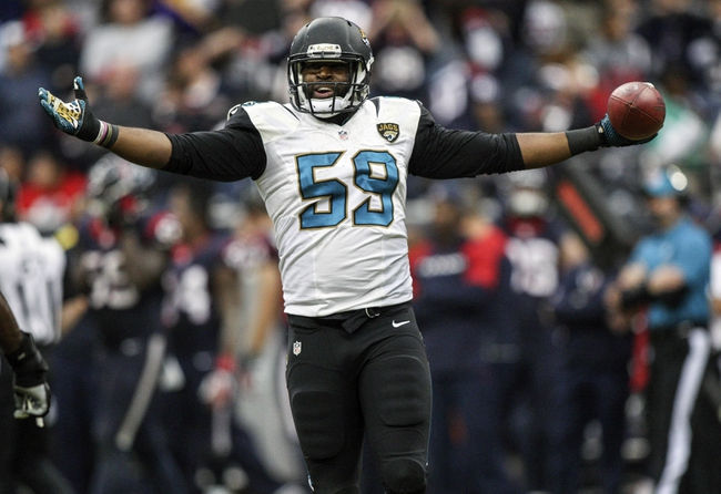 Nov 24, 2013; Houston, TX, USA; Jacksonville Jaguars defensive end Ryan Davis (59) celebrates after making an interception during the fourth quarter against the Houston Texans at Reliant Stadium. The Jaguars defeated the Texans 13-6. Mandatory Credit: Troy Taormina-USA TODAY Sports