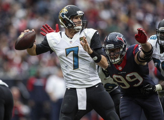 Nov 24, 2013; Houston, TX, USA; Jacksonville Jaguars quarterback Chad Henne (7) attempts a pass as Houston Texans defensive end J.J. Watt (99) applies pressure during the third quarter at Reliant Stadium. The Jaguars defeated the Texans 13-6. Mandatory Credit: Troy Taormina-USA TODAY Sports