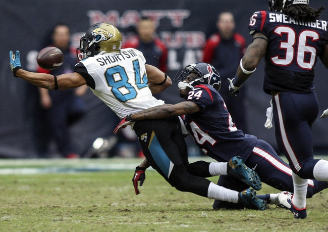 Nov 24, 2013; Houston, TX, USA; Jacksonville Jaguars wide receiver Cecil Shorts (84) attempts to make a catch during the fourth quarter as Houston Texans cornerback Johnathan Joseph (24) defends at Reliant Stadium. The Jaguars defeated the Texans 13-6. Mandatory Credit: Troy Taormina-USA TODAY Sports