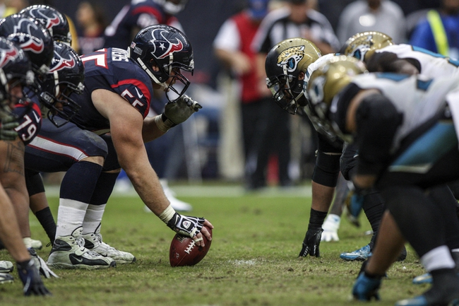 Nov 24, 2013; Houston, TX, USA; Houston Texans center Chris Myers (55) snaps the ball during the fourth quarter against the Jacksonville Jaguars at Reliant Stadium. The Jaguars defeated the Texans 13-6. Mandatory Credit: Troy Taormina-USA TODAY Sports
