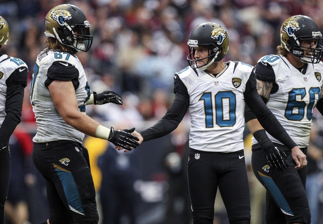 Nov 24, 2013; Houston, TX, USA; Jacksonville Jaguars kicker Josh Scobee (10) is congratulated by tackle Austin Pasztor (67) after making a field goal during the fourth quarter against the Houston Texans at Reliant Stadium. The Jaguars defeated the Texans 13-6. Mandatory Credit: Troy Taormina-USA TODAY Sports