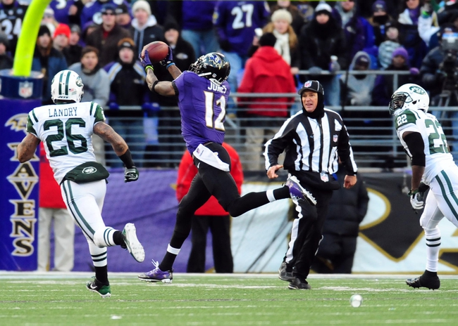 Nov 24, 2013; Baltimore, MD, USA; Baltimore Ravens wide receiver Jacoby Jones (12) catches a 66 yard touchdown pass in front of New York Jets safeties Ed Reed (22) and Dawan Landry (26) at M&T Bank Stadium. The Ravens won 19-3. Mandatory Credit: Evan Habeeb-USA TODAY Sports