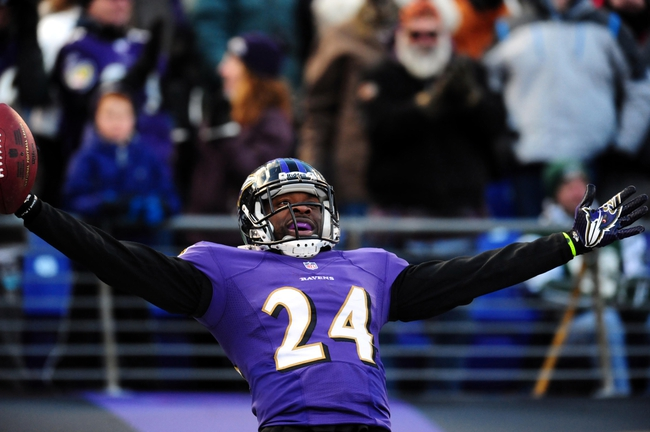 Nov 24, 2013; Baltimore, MD, USA; Baltimore Ravens cornerback Corey Graham (24) reacts after intercepting a pass in the fourth quarter against the New York Jets at M&T Bank Stadium. Mandatory Credit: Evan Habeeb-USA TODAY Sports