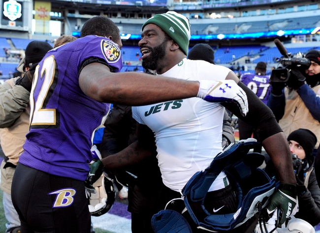 Nov 24, 2013; Baltimore, MD, USA; New York Jets safety Ed Reed (r) congratulates Baltimore Ravens wide receiver Torrey Smith (l) after their game at M&T Bank Stadium. The Ravens won 19-3. Mandatory Credit: Evan Habeeb-USA TODAY Sports