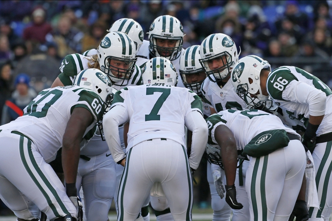 Nov 24, 2013; Baltimore, MD, USA; New York Jets players huddle during the game against the Baltimore Ravens at M&T Bank Stadium. The Ravens won 19-3. Mandatory Credit: Mitch Stringer-USA TODAY Sports