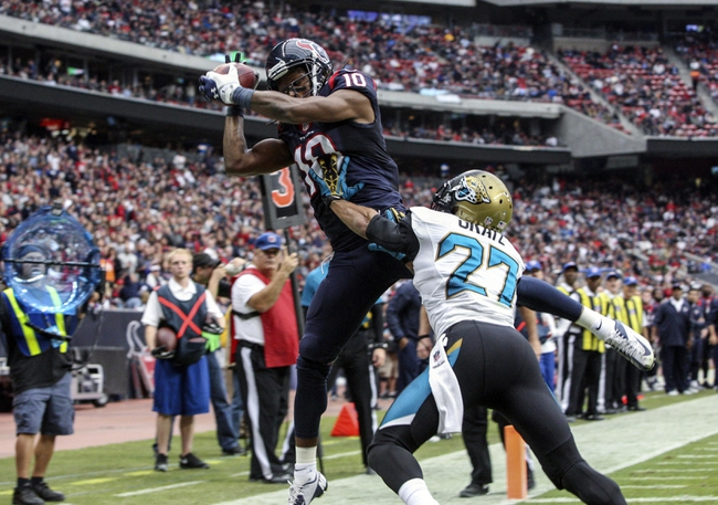 Nov 24, 2013; Houston, TX, USA; Houston Texans wide receiver DeAndre Hopkins (10) attempts to make a reception during the third quarter as Jacksonville Jaguars cornerback Dwayne Gratz (27) defends at Reliant Stadium. The Jaguars defeated the Texans 13-6. Mandatory Credit: Troy Taormina-USA TODAY Sports