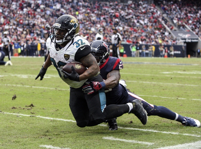 Nov 24, 2013; Houston, TX, USA; Jacksonville Jaguars running back Maurice Jones-Drew (32) attempts to run after a catch during the third quarter as Houston Texans inside linebacker Joe Mays (53) defends at Reliant Stadium. The Jaguars defeated the Texans 13-6. Mandatory Credit: Troy Taormina-USA TODAY Sports