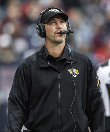 Nov 24, 2013; Houston, TX, USA; Jacksonville Jaguars head coach Gus Bradley looks up during the fourth quarter against the Houston Texans at Reliant Stadium. The Jaguars defeated the Texans 13-6. Mandatory Credit: Troy Taormina-USA TODAY Sports