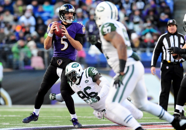 Nov 24, 2013; Baltimore, MD, USA; New York Jets defensive lineman Muhammad Wilkerson (96) prepares to throw the ball as Baltimore Ravens quarterback Joe Flacco (5) defends at M&T Bank Stadium. The Ravens won 19-3. Mandatory Credit: Evan Habeeb-USA TODAY Sports
