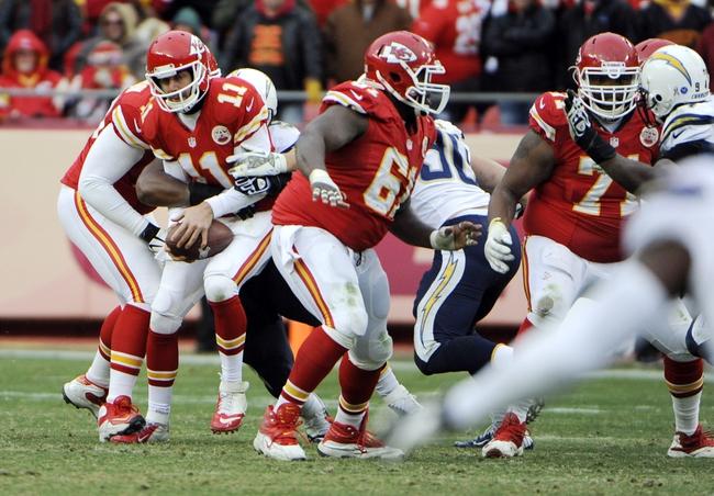 Nov 24, 2013; Kansas City, MO, USA; Kansas City Chiefs quarterback Alex Smith (11) is sacked by the San Diego Chargers in the second half at Arrowhead Stadium. San Diego won 41-38. Mandatory Credit: John Rieger-USA TODAY Sports